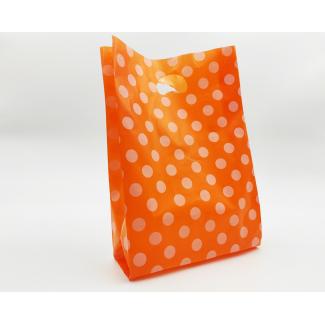 """shopper in plastica hdpe arancione con fantasia """"pois"""" bianchi, maniglia fustellata a fagiolo, confezione da 5 kg."""