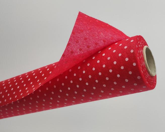Tovaglia in tessuto non tessuto (TNT), base rossa con fantasia pois bianchi, confezionata in rotolo da 1.60x10mt.