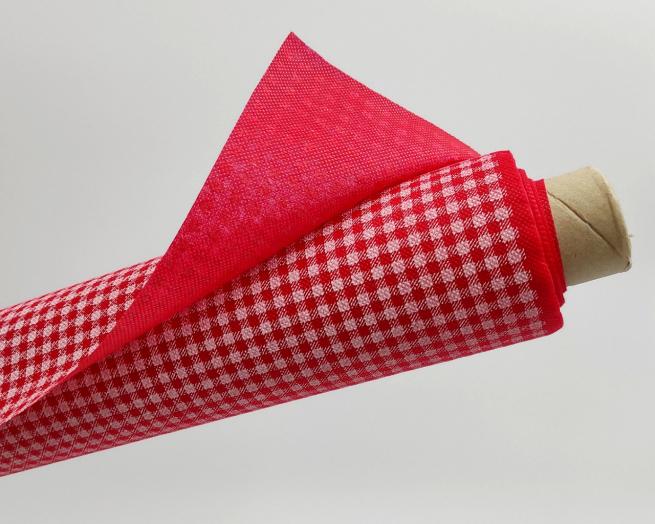 Tovaglia in tessuto non tessuto (TNT), con fantasia vichy a quadrettini bianchi e ROSSI, confezionata in rotolo da 1.60x10mt.